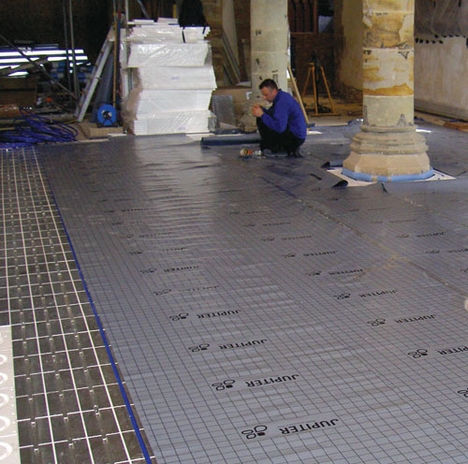 EPS Edge Zone panels were covered with a protective membrane, over which the heating system and Screed Replacement Tiles were laid.