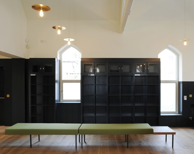 The library is lined with black MDF shelving.