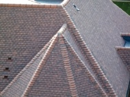 This development used Marley Eternit Acme double camber clay plain tiles in Antique.