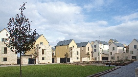 The buildings make use of a traditional palette of Portland stone and cream render.