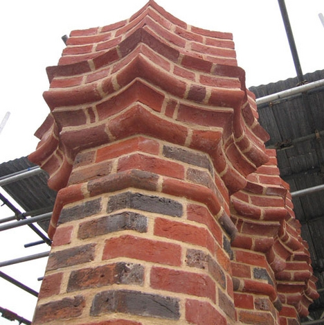 The Tudor scalloped pattern was recreated with new bricks.