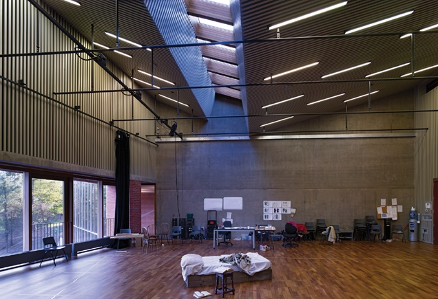 The top-lit rehearsal room is lined in pin-striped acoustic battens.