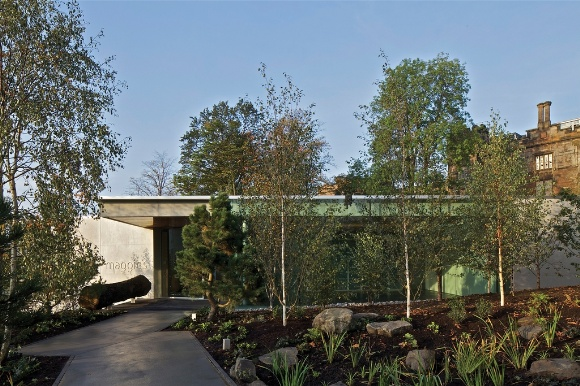 With its full height glazing, cantilevered floors and deep, projecting soffits, the Maggie's Centre has strong echoes of a Case Study house, perched on the hillside.