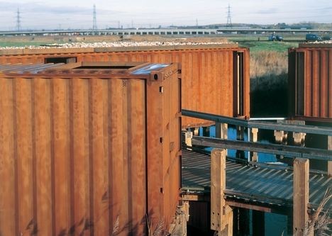 The corten steel containers come from China. The composting toilet stands in the foreground.
