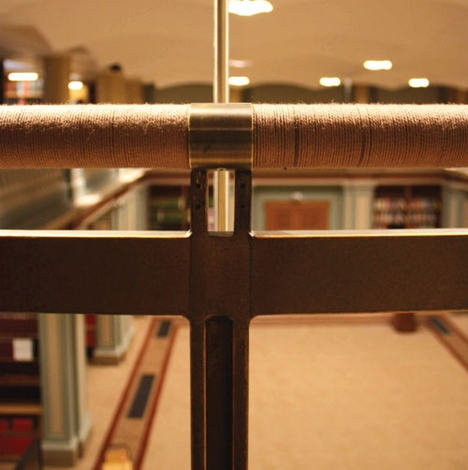 The bronze-plated baluster and cord-covered handrail on the library bridge.