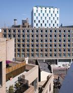 The lower brick block with the aluminium-clad tower behind in Southwark, south London.