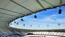 A wafer-thin cable net roof, free of the hulking retractable apparatus of Wembley, is stretched taut to cover the top tier of seats
