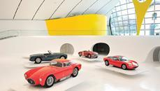 The cars are displayed on elevated plinths, giving them the look of Matchbox toys.