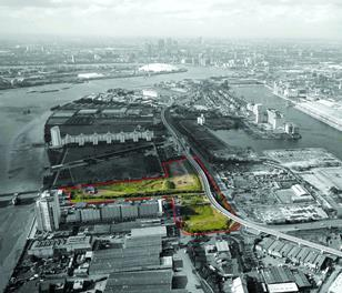 Looking west over the Royal Docks site towards Canary Wharf.