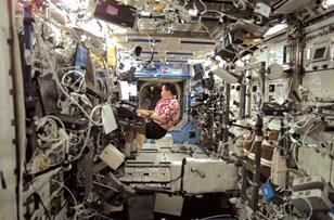NASA astronaut Edward Lu plays a musical keyboard inside the US laboratory module Destiny in October 2003.