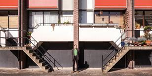 Greg Penoyre in front of Basterfield House on the Golden Lane Estate.