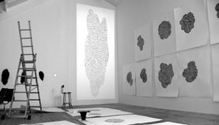 Susanna Heron's drawings for the glass designs adorn the walls of her studio. The large image of (centre) is a projection at the actual size of one of the panels.