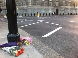 Flowers left in tribute at the roundabout where Moira Gemmill died