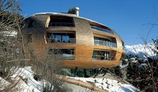 The kidney bean-shaped Chesa Futura apartments in St Moritz by Foster's.