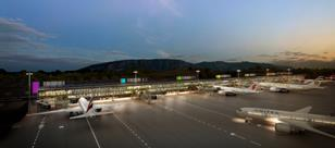 External dusk view of Geneva Airport - Rogers Stirk Harbour & Partners
