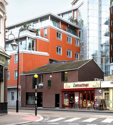 Access to the restaurant, on a site next to a large block of flats, is constrained by the narrow pavement and busy one-way system.